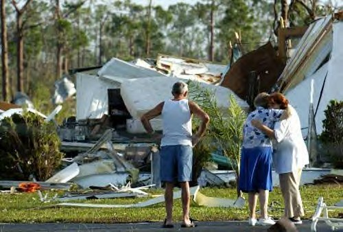 Local residents console each other Saturday, Aug. 14, 2004 in Punta Gorda FL