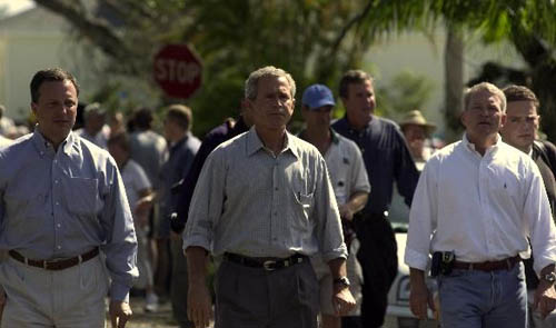 President George W. Bush walks with FEMA