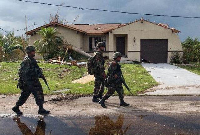 2004-08-16 - Florida National Guard patrol a damaged neighborhood in Port