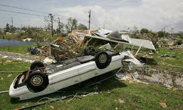 Overturned car sits next to the remains of a Mobile Home at Crystal Lake Mobile Home Trailer Park in Punta Gorda FL
